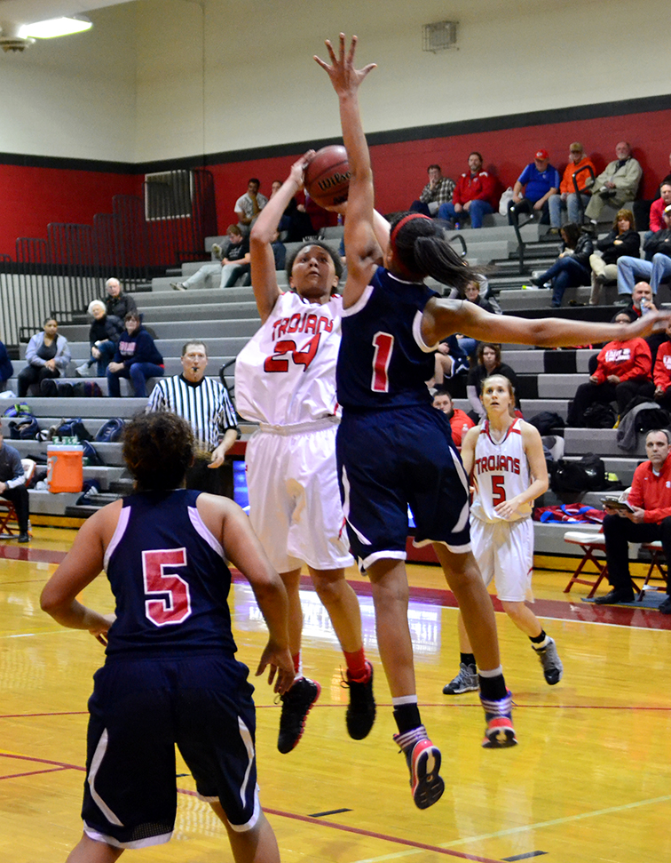 BRYCE MERENESS/Citizen photo Park Hill senior Riana Everidge, center, attempts a shot during a game versus Truman on Monday, Feb. 9 at Park Hill High School in Kansas City, Mo.