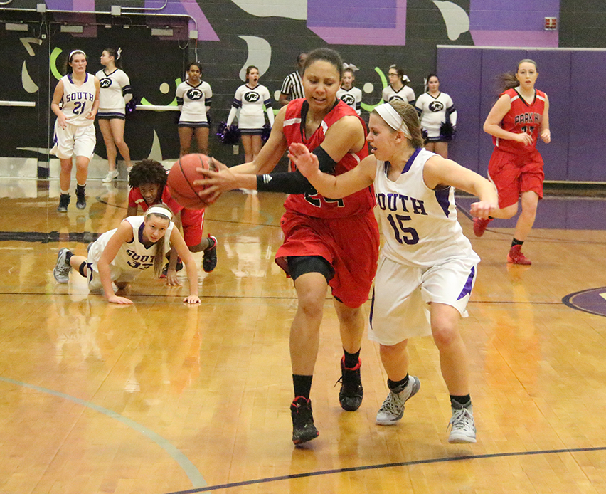 ROSS MARTIN/Citizen photo Park Hill senior Riana Everidge, center, drives to the basket against Park Hill South's Erica Tmmerman (15) during a game on Friday, Feb. 13 at Park Hill South High School in Riverside, Mo.