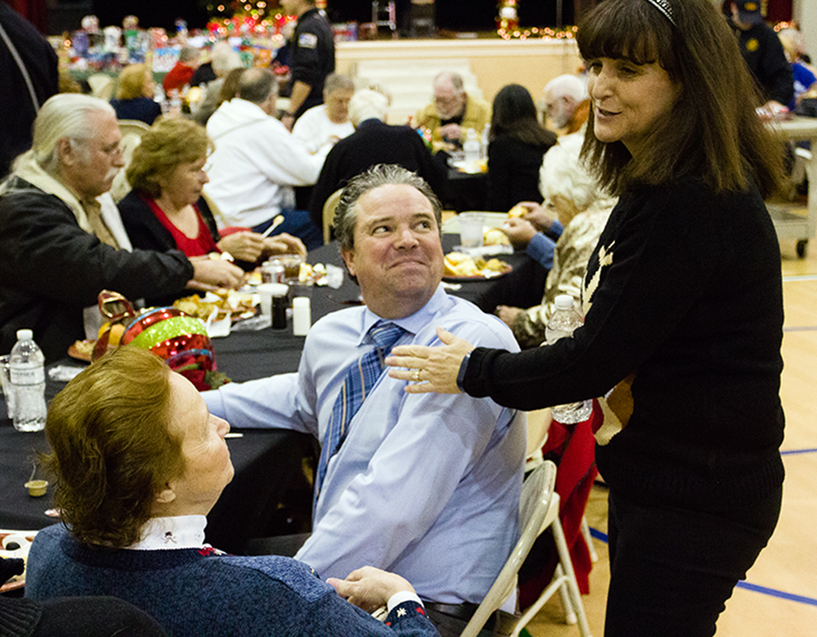 CORY MACNEIL/Citizen photo Riverside mayor Kathy Rose takes time to talk with guests during the city's annual seniors holiday dinner held Tuesday, Dec. 8 at Riverside Community Center in Riverside, Mo.