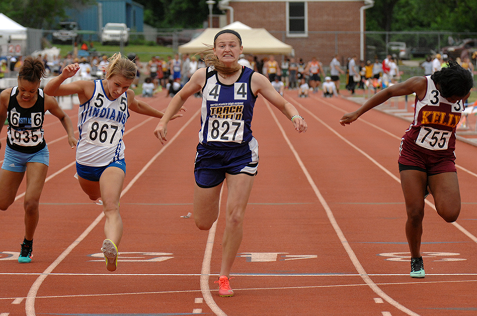 WC FARMER/Citizen photo North Platte senior Regan Nash crosses the finish line of the Class 2 Missouri State Track and Field Championships' 100-meter dash final on Saturday, May 23 at Dwight T. Reed Stadium in Jefferson City, Mo. Nash won her second straight title in the event.
