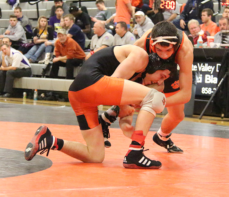 Platte County junior Matthew Schmitt, left, takes down Oak Grove's Shawn Kavadas in the 126-pound championship match during the Platte County Invitational on Saturday, Jan. 24 at Platte County High School.