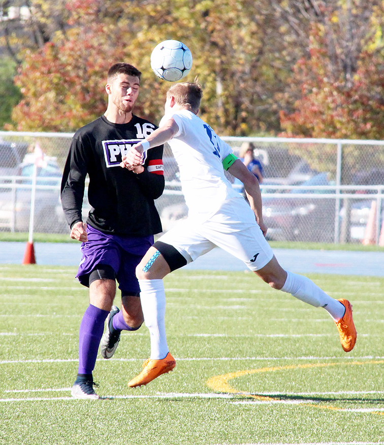 ROSS MARTIN/Citizen photo Park Hill South senior defender Seth Hudson (16) fights for a header during the Panthers' Class 4 quarterfinal match with Rockhurst on Saturday, Nov. 7 at Rockhurst High School in Kansas City, Mo.