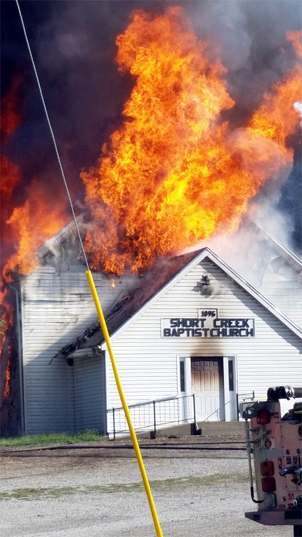 Contributed photo Flames burst out of Short Creek Baptist Church on Saturday, Sept. 12 near Rushville, Mo. A fire reported early that morning ended up completely destroying the 120-year-old building, located in rural northwestern Platte County.
