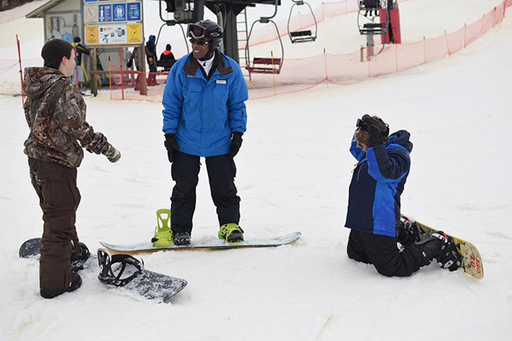 BRYCE MERENESS/Citizen photo A Snow Creek Ski Area instructor, center, works with two students during a ski lesson Friday, Jan. 9 near Weston, Mo.