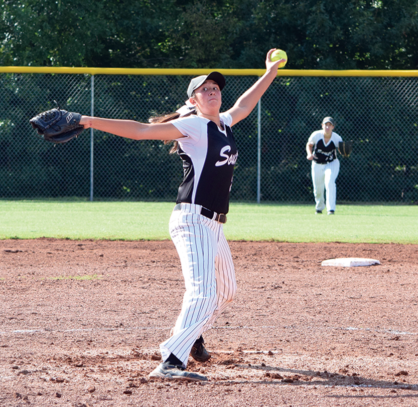 BRYCE MERENESS/Citizen photo Park Hill South pitcher Carolyn Stock delivers a pitch against Park Hill on Wednesday, Sept. 9 at Park Hill South High School in Riverside, Mo.