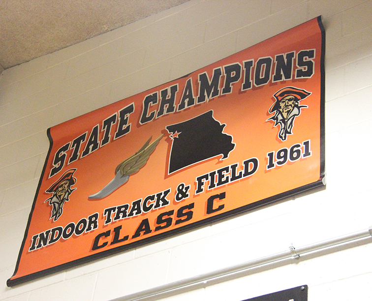ROSS MARTIN/Citizen photo Platte County High School officials hung a banner last week in the main gymnasium, honoring the 1961 Class C indoor track and field state championship team. After a short verification process, the group now holds the distinction as the first team state champion in the school's history.