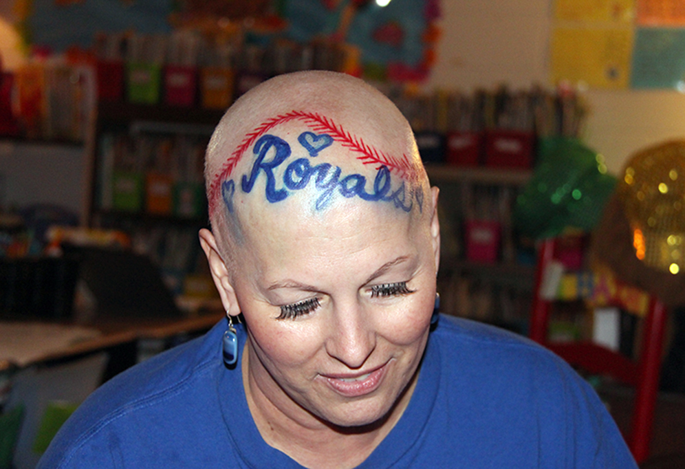ROSS MARTIN/Citizen photo Stephanie Jermain — a first grade teacher at Siegrist Elementary in the Platte County R-3 School District — recently told her students about her ongoing fight with cancer. Diagnosed with an aggressive form of breast cancer at the end of of last school year, she recently finished up her eighth and final round of chemotherapy and decided not only to tell her class about cancer and its effects but used the opportunity to decorate her head in honor of the Kansas City Royals.