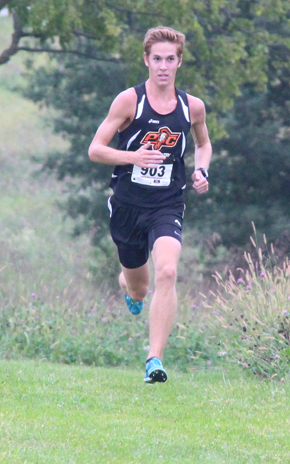 ROSS MARTIN/Citizen Photo Platte County senior Nathan Straubel runs for the finish Thursday at Platte Ridge Park in the Platte County Cross Country Invitational.