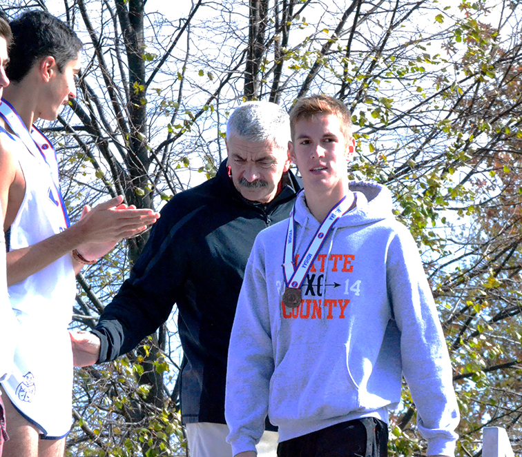 BRYCE MERENESS/Citizen photo Platte County senior Nathan Straubel accepts his medal after placing fifth in the Class 4 Missouri State Cross Country Championships on Nov. 8 at Oak Hills Golf Center in Jefferson City, Mo.