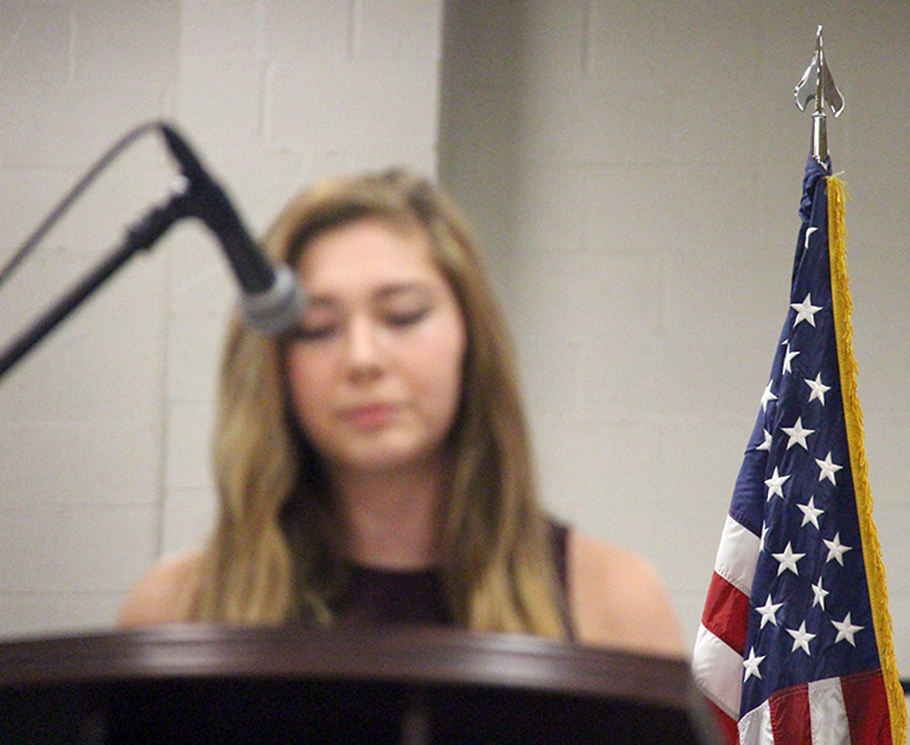 Platte County student Mark Calhoun (top) gave a speech on being in military family, while fellow student Helena Dabney (bottom) read her original poem Platte County High School's Veterans Day Salute held Wednesday, Nov. 11.