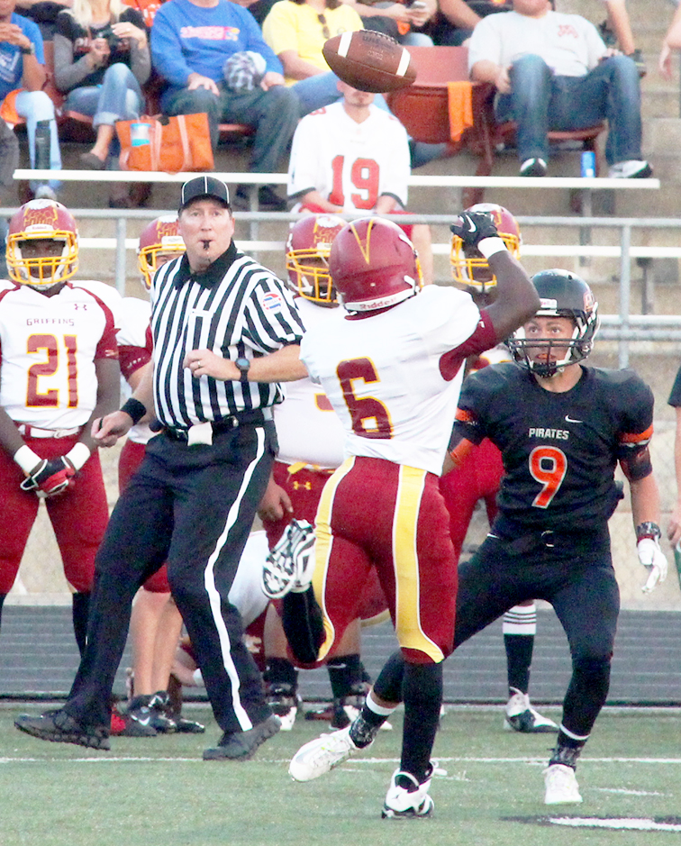 ROSS MARTIN/Citizen photo Platte County wide receiver TJ Guillory (9) watches a pass against Winnetonka on Sept. 19 at Pirate Stadium. The Pirates won 35-19 and moved into the No. 8 spot in the lastest Missouri Media Class 4 Poll released Sept. 23.