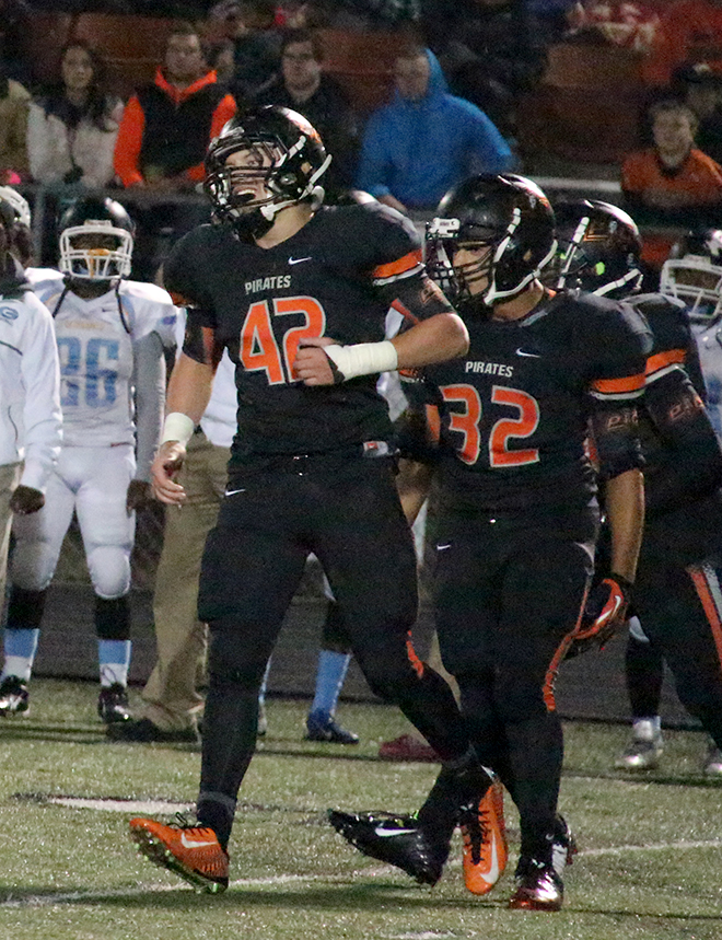 ROSS MARTIN/Citizen file photo Platte County linebacker Topher Kilkenny (42) celebrates a tackle in a game against Grandview on Oct. 8  at Pirate Stadium. Kilkenny was named to the second team of the Missouri media all-state team released this week.