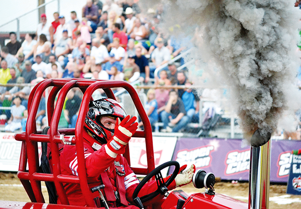 Roger Hill of Platte City reacts after his run in the Lucas Oil Pro Pulling League competition Saturday, July 25 at the Grandstand inside the Platte County Fairgrounds in Tracy, Mo.