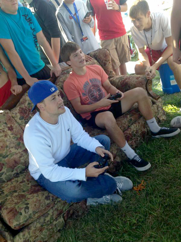 Contributed photo Platte County Citizen editor Ross Martin, left, and Platte County High School senior Ethan Karsten sit on a thrift store couch during a tailgate ahead of the Pirates' football game Friday, Sept. 11. The two competed in a video game challenge, playing FIFA 16.