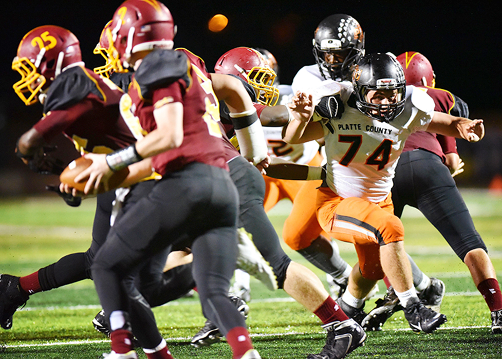 TODD NUGENT/Special to the Citizen Platte County senior defensive lineman Tyler Blankenship, right, fights through blocks against Winnetonka on Friday, Sept. 18 at North Kansas City District Stadium in North Kansas City, Mo.