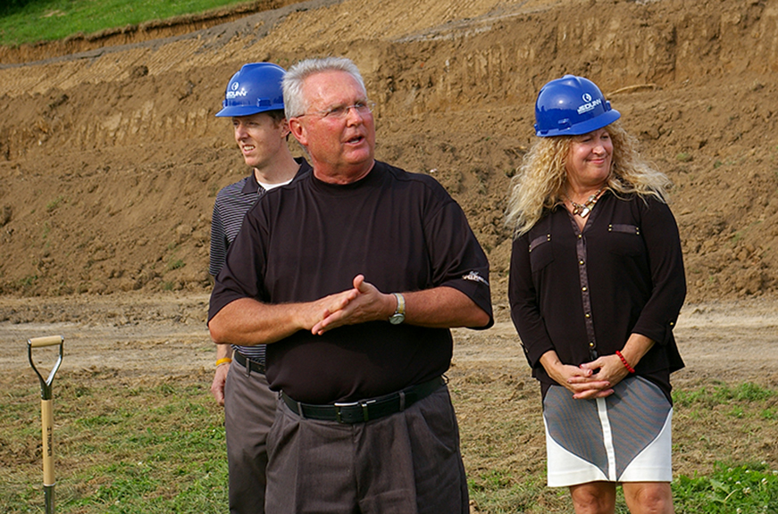 JEANETTE BROWNING FAUBION/Citizen photo West Platte special projects manager Dr. Mark Harpst, front, speaks to those in attendance during a groundbreaking ceremony held Wednesday, June 17 on the school campus in Weston, Mo. Work on the first phase of a new facilities project, which includes a new athletic stadium, has already begun.