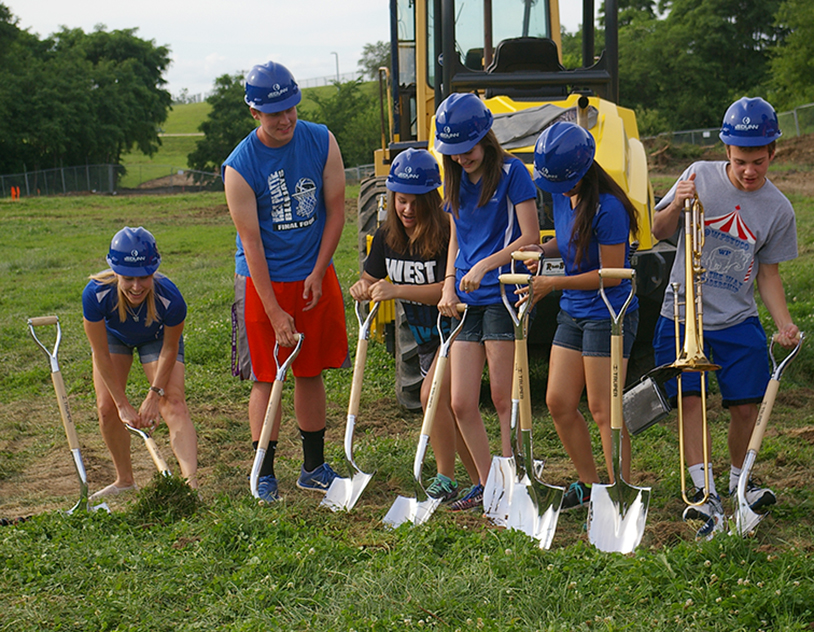 JEANETTE BROWNING FAUBION/Citizen photo West Platte teacher Ms. Rebecca Fillingham, left, and students (from left to right) Johah Vandel, Taylor McNair, Alessandra Cutolo-Ring, Sarah Von Seggern, Connor McNair and Logan Lee participated in the district's groundbreaking ceremony for its new construction project, held Wednesday, June 17 in Weston, Mo.