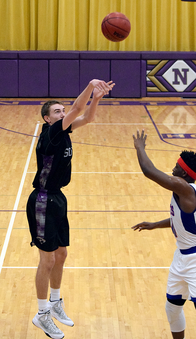 BRYCE MERENESS/Citizen photo Park Hill South senior Ryan Welty, left, takes a 3-point shot against Truman in the third-place game of the Northtown Classic on Saturday, Jan. 23 in North Kansas City, Mo.