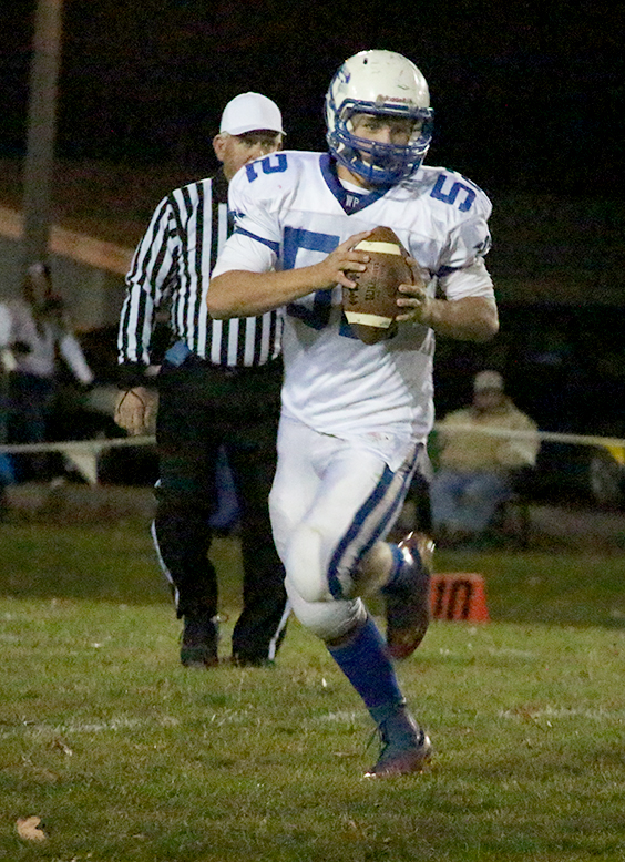 ROSS MARTIN/Citizen photo West Platte quarterback and offensive tackle Brett Shepardson rolls outon a run play during the Class 1 District 7 championship game Nov. 7 against Plattsburg in Plattsburg, Mo.