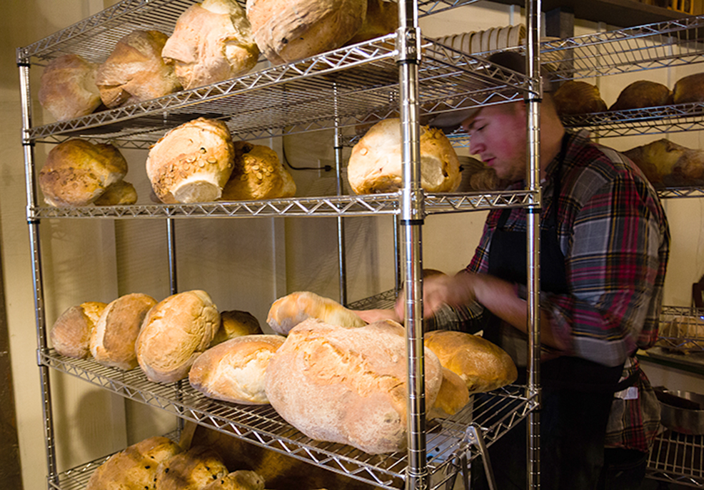 Low, 21, of Weston, Mo. prepares some of his bread products at Hearth, which is the only wood-fired bread store in Missouri.