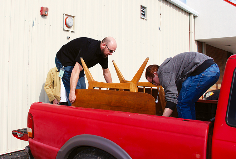 ROSS MARTIN/Citizen photo Hillcrest assistant manager Dave Seim, left, and 17-year-old Xavier Babcock help load a purchased table into a customer's truck outside of the store last month.