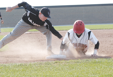 Park Hill's Zach Serrano, right, dove safely back to the first base bag Monday afternoon in the Trojans' loss to Lee's Summit West.  LEE STUBBS/Citizen photo
