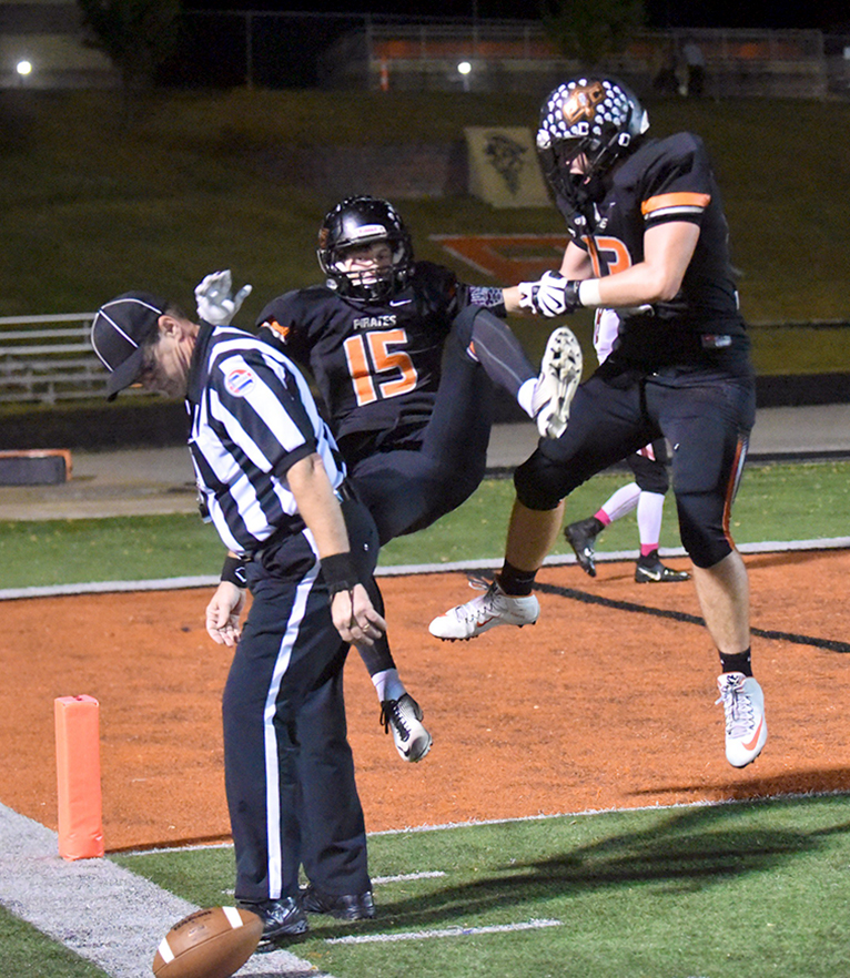 TODD NUGENT/Special to The Citizen Platte County junior offensive tackle Derek Kohler, right, knocks over senior wide receiver Zach Hamilton (15) after he scored a touchdown in a Class 4 District 8 matchup with St. Joseph Benton on Friday, Oct. 23 at Pirate Stadium.