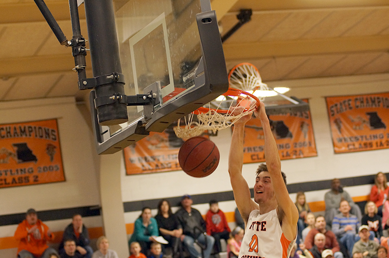 Chris Patterson/Citizen photo Platte County senior forward Sam Zimmerman dunks the ball in a game against St. Joseph Central on Friday, Jan. 9 at Platte County High School.