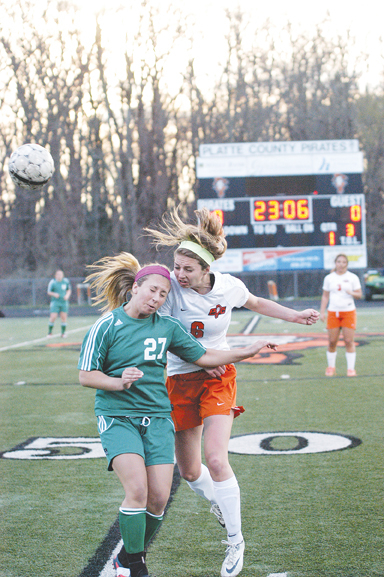 Platte County's Addie Jenkins, right, battled Smithville's Karina Gromacki for the ball Monday night. LEE STUBBS/Citizen photo
