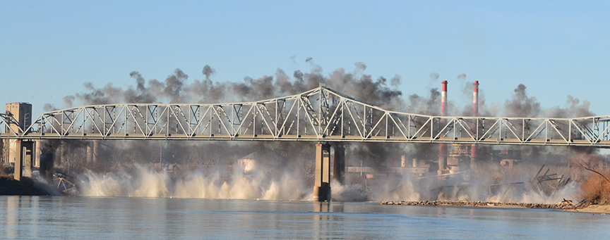BRYCE MERENESS/Citizen photo Remnants of the over-water spans of the Fairfax Bridge splash into the Missouri River during a planned implosion held Saturday, Jan. 24 near Riverside, Mo. in southern Platte County. The third and final stage of the demolition is slated for Thursday, Jan. 29.