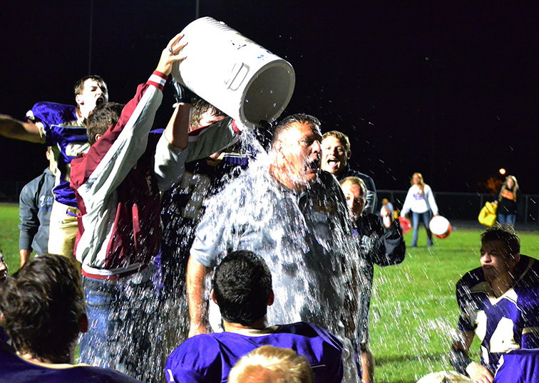 BRYCE MERENESS/Citizen photo North Platte players dump a water cooler on coach Jim Brockhoff on Sept. 5 at North Platte High School in Dearborn, Mo., celebrating the Panthers' first win since 2012.