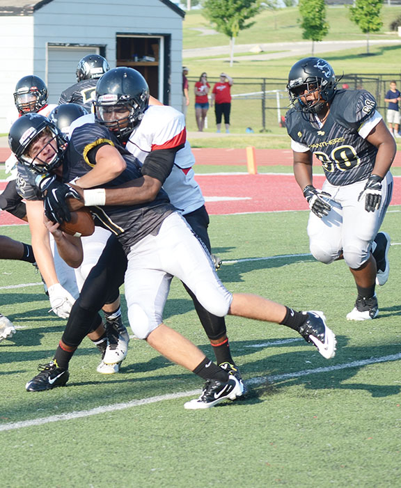 LEN LEHMANN/Special to The Citizen Park Hill junior defensive end Chester Graves sacks a Raymore-Peculiar quarterback in a preseason jamboree held Friday, Aug. 14 at Park Hill District Stadium in Kansas City, Mo.