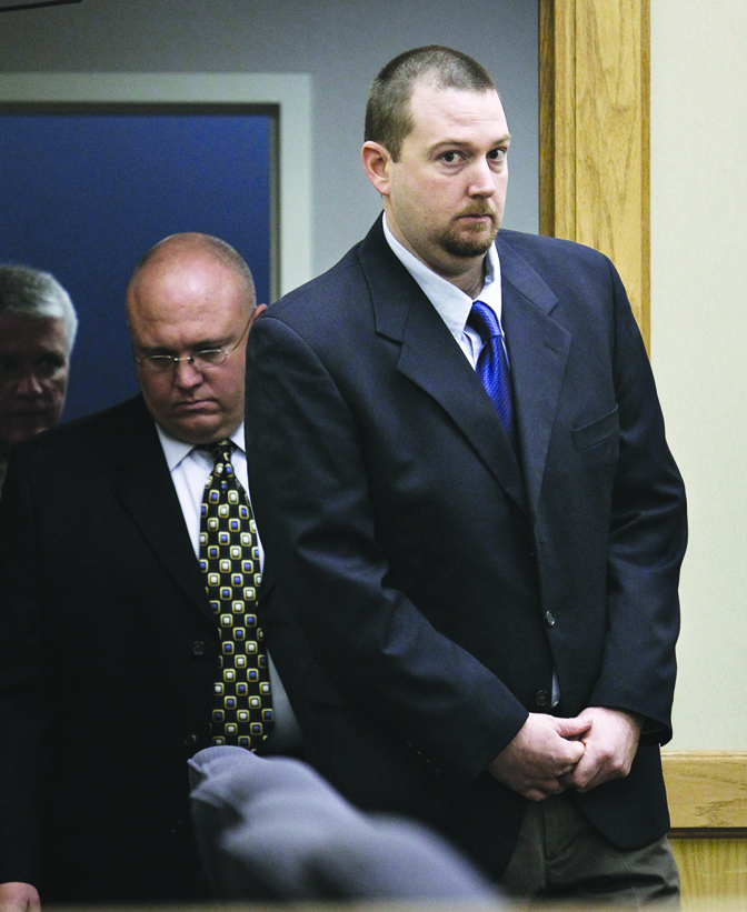 Clifford D. Miller (right) was brought into Platte County Circuit Court on Tuesday, April 23, 2013, where he plead guilty to two counts of first-degree murder in the deaths of Britny Haarup and Ashley Key. He was sentenced to life in prison with no chance of parole on both charges. Circuit judge Owens Lee Hull Jr. decided that he must serve those life sentences back-to-back. Pool photo by KEITH MYERS/The Kansas City Star
