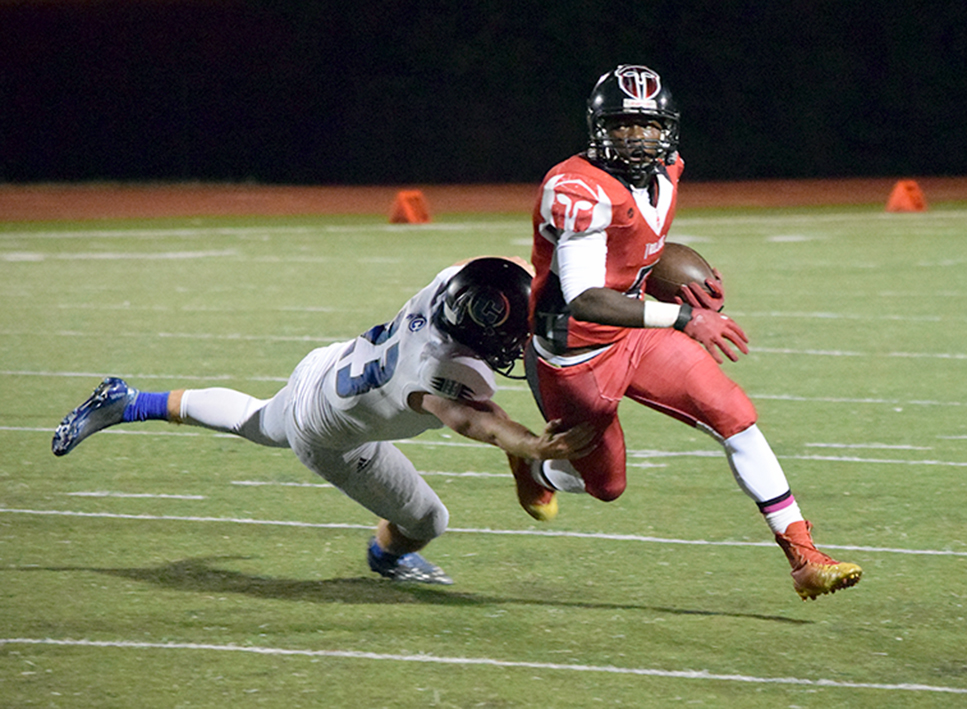 BRYCE MERENESS/Citizen photo Park Hill sophomore running back Dorian Clayton skirts by a tackle from St. Joseph Central linebacker Jake Hill on Friday, Oct. 9 at Park Hill District Stadium in Kansas City, Mo. Clayton finished with a career-high 168 yards on 17 carries.
