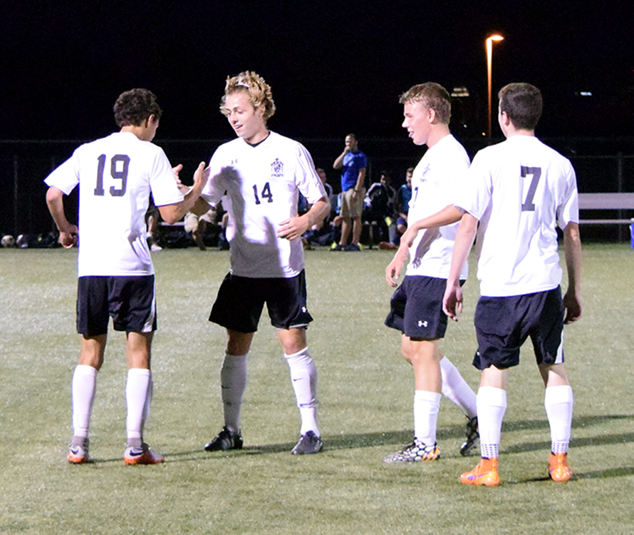 BRYCE MERENESS/Citizen photo Park Hill South players, from left, Noah Anderson, Dan Geary, Brandon Fitzgerald and Michael Panella celebrate following Geary's goal in the 71st minute against St. Joseph Central on Monday, Sept. 14 at Park Hill District Soccer Complex in Riverside, Mo.
