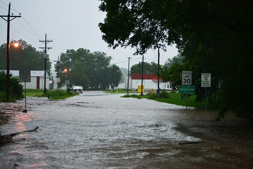 BRYCE MERENESS/Citizen photo Water washed over the roadway on Highway Z near the city limits of Edgerton, Mo. during flash flooding that occurred in the area on Monday, July 6. Some of the heaviest rain during a round of thunderstorms was recorded in Edgerton.