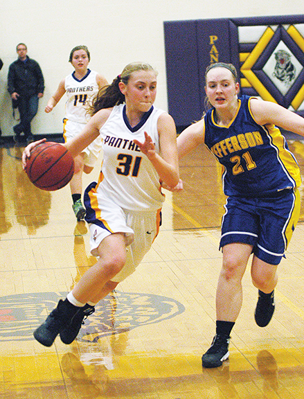 North Platte's Erin Manville drove past a Jefferson defender in the Lady Panthers' win in the championship game of their own invitational tournament last week. LEE STUBBS Citizen photo