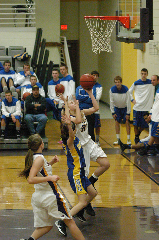 North Platte's Erin Manville had the attention of the East Buchanan boys basketball team as she drove to the basket for two of her game high 12 points last Friday. The Lady Panthers beat the East Buch girls 55-24.
