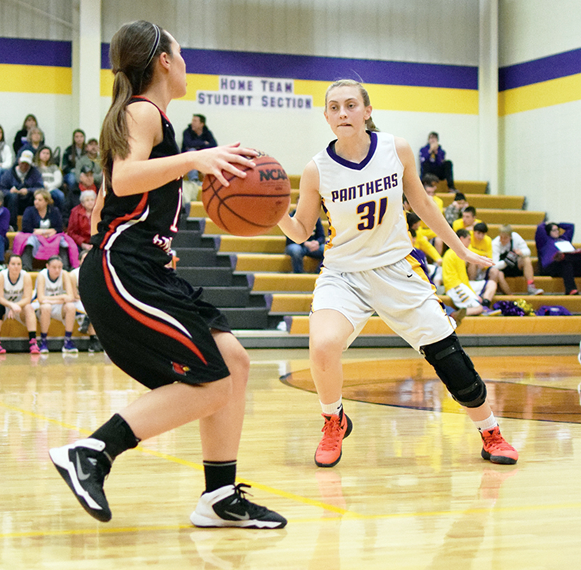 BRYCE MERENESS/Citizen photo North Platte senior guard Erin Manville, right, recently returned to action after recovering from a left ACL tear.