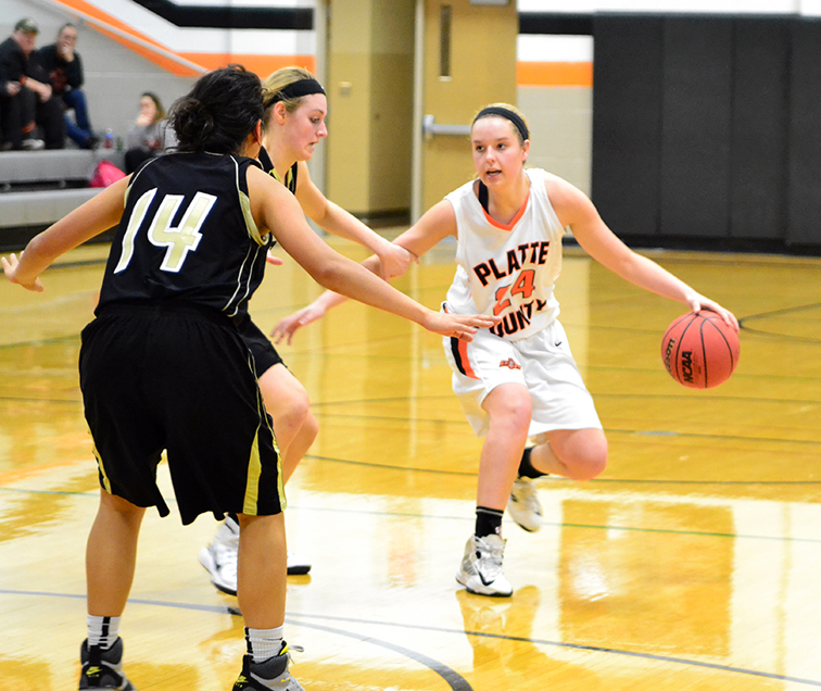 BRYCE MERENESS/Citizen photo Platte County junior Madysen Fine, right, dribbles during a game against Raymore-Peculiar on Monday, Feb. 2 at Platte County High School.