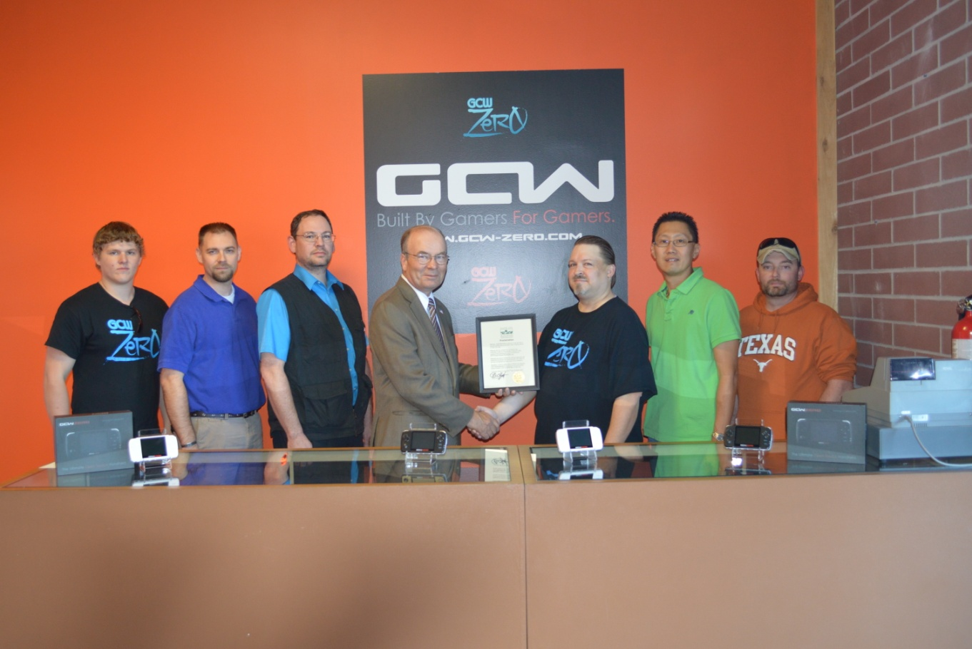 Game Consoles Worldwide, LLC was welcomed to Platte City in a ceremony last week. Pictured, from left — Kaleb Lorg-Barwick, Jason Parkes, John McPherson, Platte City Mayor Frank Offutt, Justin Barwick, Kyong Pak and Thad Crawford. The business is located at 1302 Platte Falls Road, Suite G in Platte City.