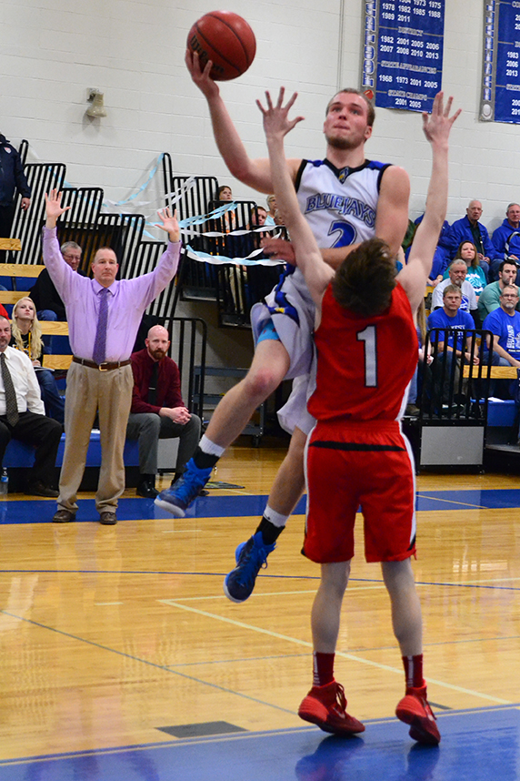 BRYCE MERENESS/Citizen photo West Platte senior Cody Guthrie, rear, goes up for a shot against Lawson sophomore Max Ross (1) during a game on Friday, Feb. 13 at West Platte High School in Weston, Mo.