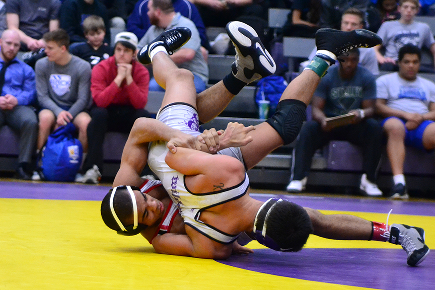 BRYCE MERENESS/Citizen photo Park Hill senior Ke-Shawn Hayes, left, works to turn Blue Springs' Joe King during the 138-pound championship bout of the Class 4 District 4 Tournament on Saturday, Feb. 14 at Blue Springs High School in Blue Springs, Mo.