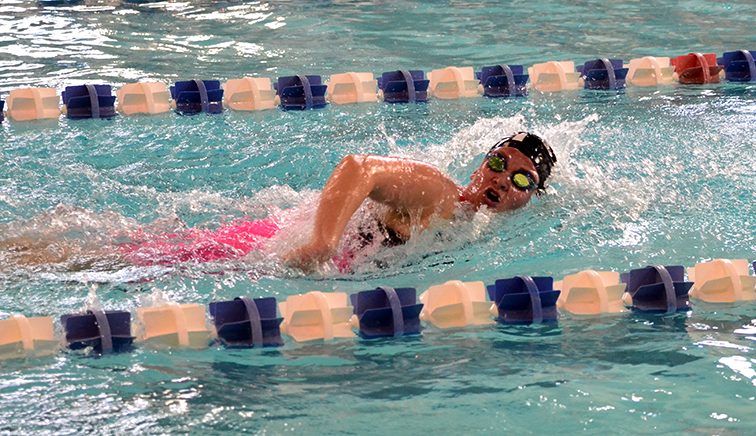 BRYCE MERENESS/Citizen photo Park Hill's Madison Heydinger competes in the 500-yard freestyle event during the Northland Invitational on Saturday, Jan. 10. at the Gladstone Community Center in Gladstone, Mo. Park Hill finished third in the 23 team field with Park Hill South claiming the title.