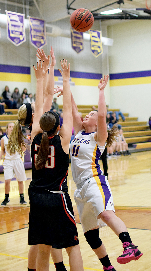 BRYCE MERENESS/Citizen photo North Platte senior forward Kaycee Hodgson (11) takes a shot against a pair of North Andrew defenders during a game Monday, Jan. 4 at North Platte High School in Dearborn, Mo.