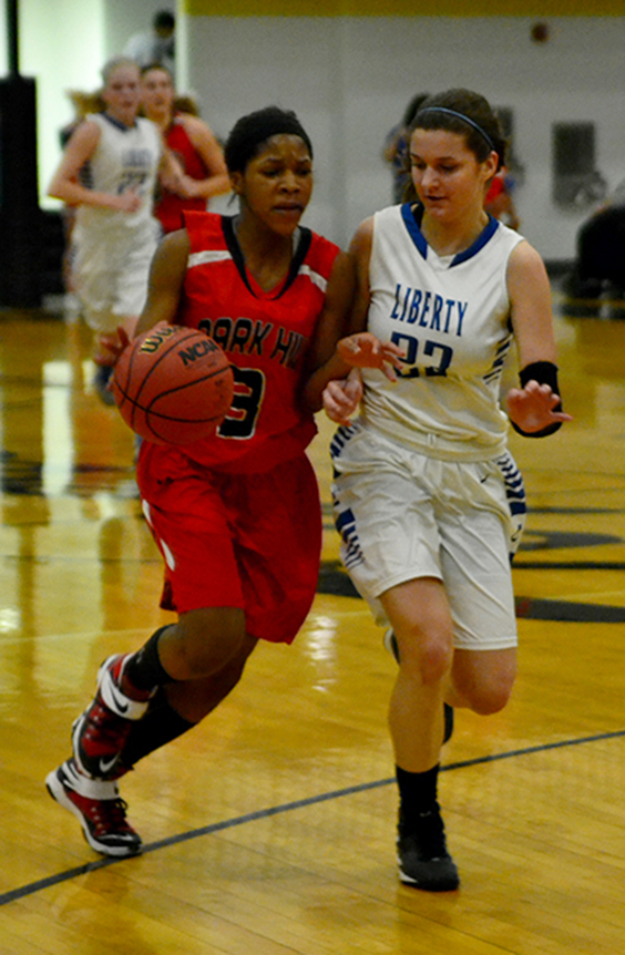 BRYCE MERENESS/Citizen photo Park Hill guard Gigi Hopkins, left, drives to the basket in a Class 5 sectional game against Liberty on Wednesday, March 11 at Excelsior Springs High School in Excelsior Springs, Mo.