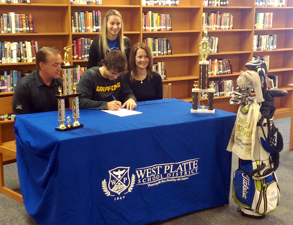 BRYCE MERENESS/Citizen photo West Platte senior Luke Horseman, center, signs on the dotted line to play golf at Missouri Western State Univesity on Friday, Nov. 13 at West Platte High School in Weston, Mo.