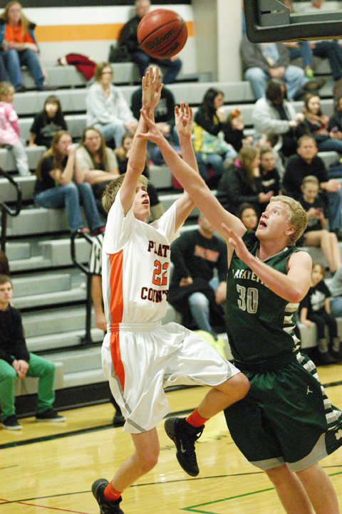 Platte County Jake Eastman shot over St. Jospeh Lafayette's Cole Lehman last Friday night at Platte County HIgh School.