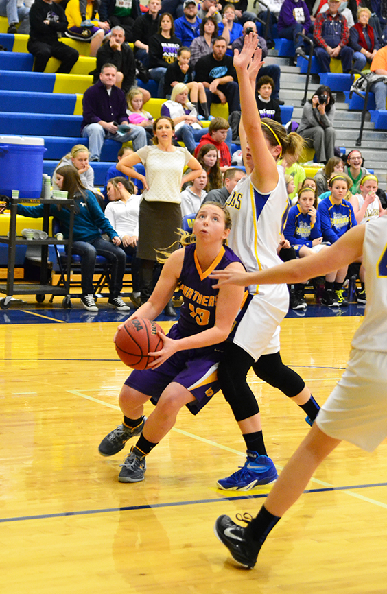 BRYCE MERENESS/Citizen photo North Platte guard Sarah Johnson, left, drives to the basket in a game against East Buchanan on Friday, Dec. 19 at East Buchanan High School in Gower, Mo.