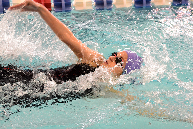 BRYCE MERENESS/Citizen photo Park Hill South's Ava Kinsland competes in the 100-yard backstroke Saturday, Jan. 10 at the Gladstone Community Center in Gladstone, Mo. during the Northland Invitational.